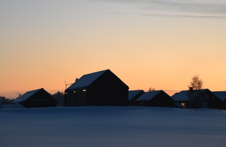 Farmhouses, winter sunset, under crescent moon